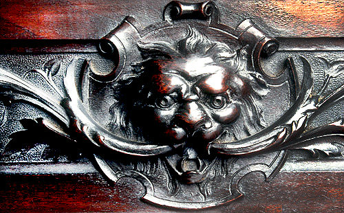 Green Man, carving on lntel of tallboy secretaire, by W.S.Williamson, circa 1903, private property
