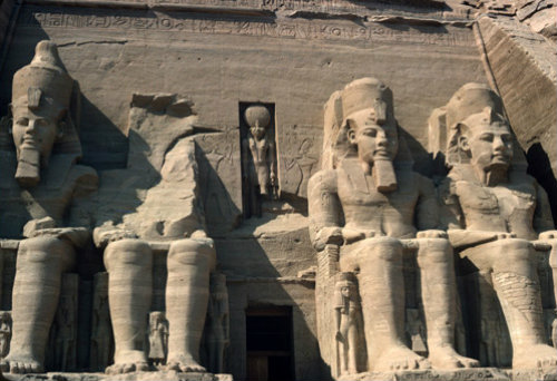 Egypt, Abu Simbel, Temple of Ramesses II, four seated colossi of Ramesses II on temple facade
