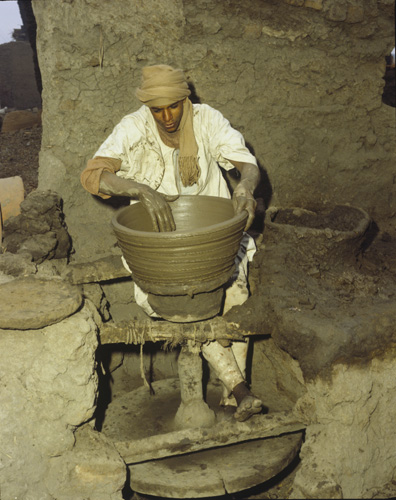Potter at wheel in village between Asyut and Cairo, Egypt