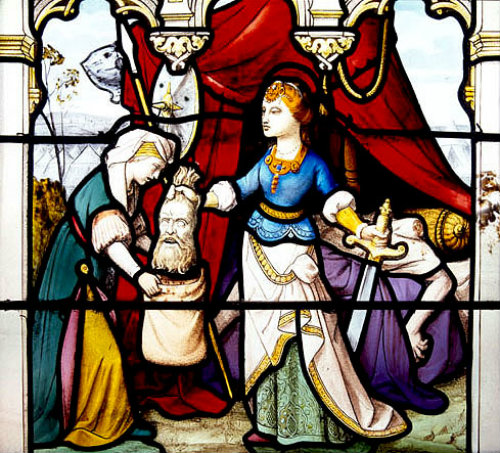 Judith with the head of Holofernes, 19th century stained glass, Church of St Aignan, Chartres, France