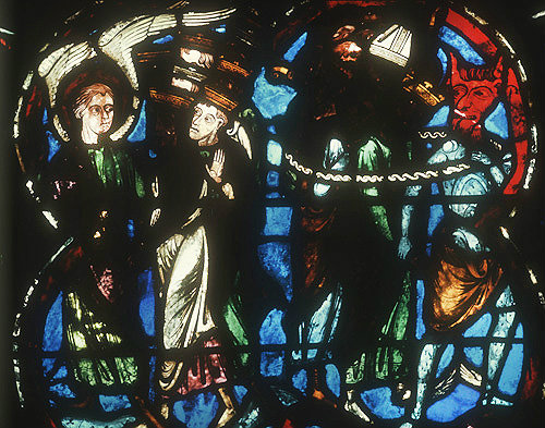 Angel leading souls to heaven, Devil leading the wicked to hell, detail from thirteenth century Last Judgement window, Bourges Cathedral, Bourges, France