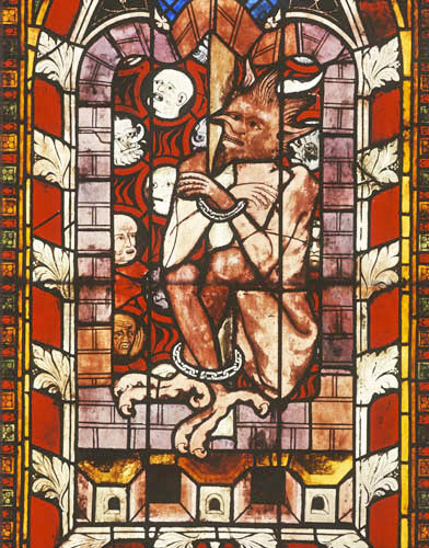 The chained devil from the resurrection window in Chapel of St Lawrence, Strasbourg Cathedral, France