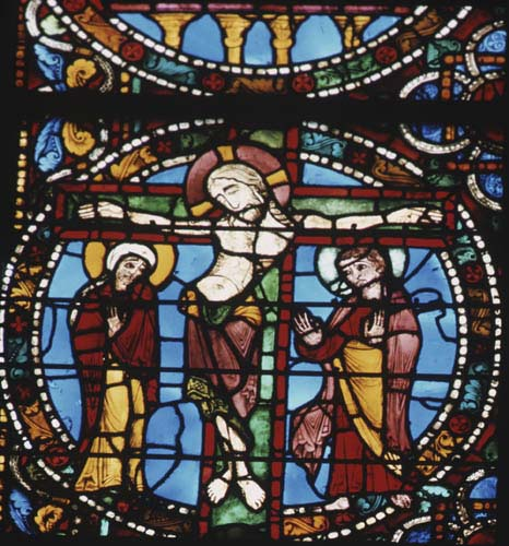 Crucifixion scene from the Passion window, 12th century stained glass, west end, Chartres Cathedral, France