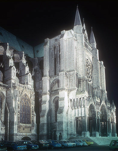 South transept and porch, window of Vendome Chapel on left, floodlit, Chartres Cathedral, France