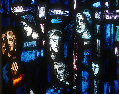 Salisbury Cathedral, Trinity Chapel, Prisoners of Conscience window by Gabriel Loire, lancet E, detail of panel 11, six heads, in Gabriel Loire