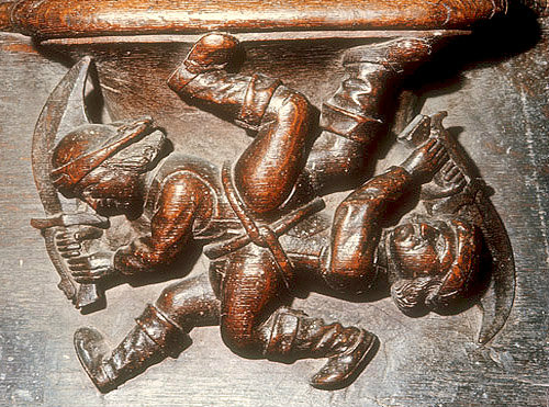 Misericord of sword play at the fair, fifteenth century, Church of La Trinite, Vendome, France