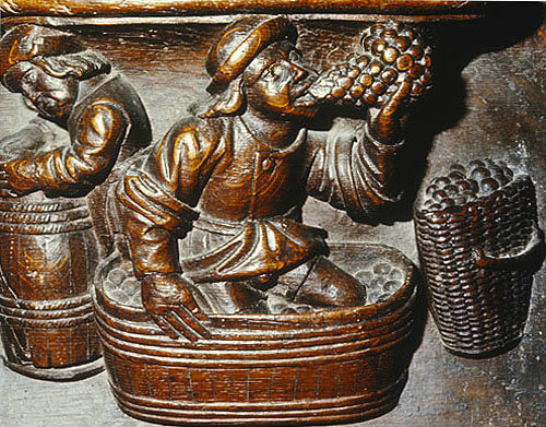 Misericord of wine making,  month of October. fifteenth century, Church of La Trinite, Vendome, France