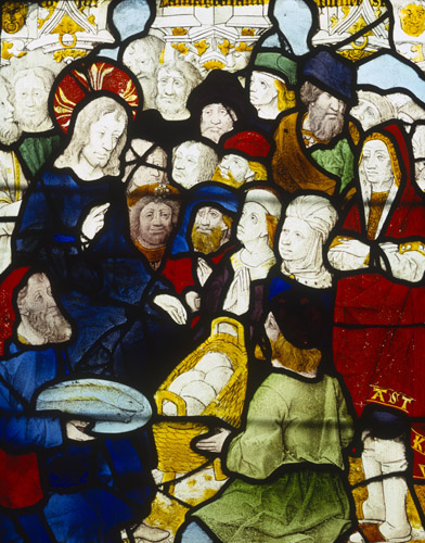 Jesus feeding the five thousand, the miracle of the loaves and the fishes, 16th century stained glass, Church of St Pierre, Dreux, France
