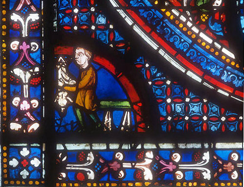 Butcher (a donor), Miracles of Mary window, circa 1210, Chartres Cathedral, France