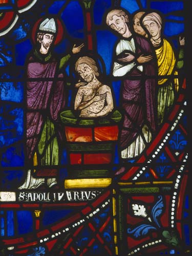 St Apollinaris, detail of saint baptising a man, 13th century stained glass, south transept, Chartres Cathedral, France