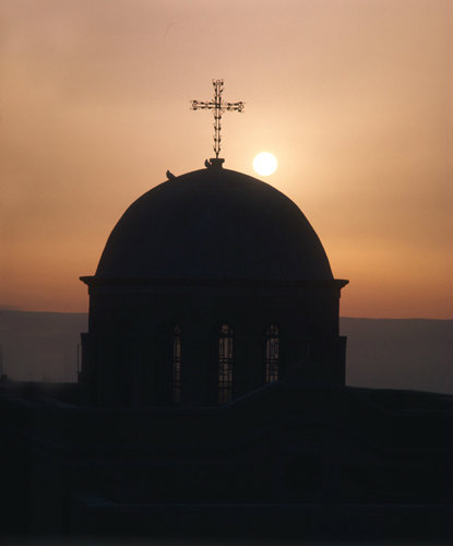 Israel, Bethany, doves on Dome of Church at sunrise