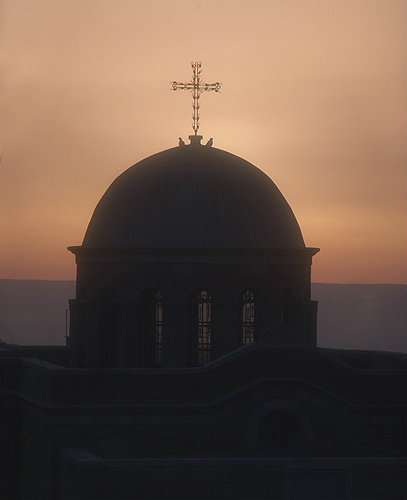 Doves and cross on dome of church at sunrise, Bethany, Israel