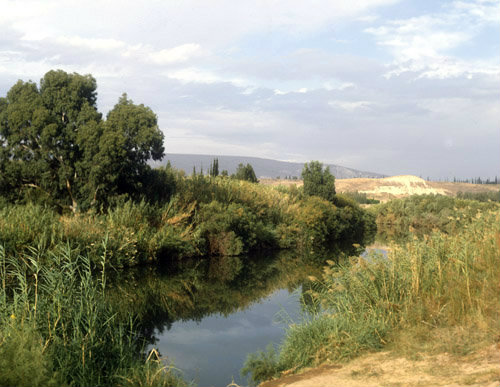 Israel, river Jordan south of Galilee, mountains of Gilead in distance