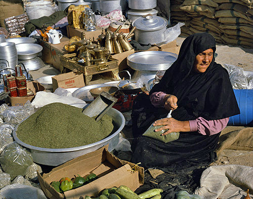 Israel, Beersheva, market, Bedouin woman scooping up tea
