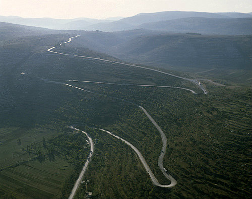 Israel, aerial view of Samarian hills and twisting road