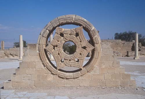 Rose window reerected by archaeologists in main courtyard of Hishams Palace, near Jericho, Israel