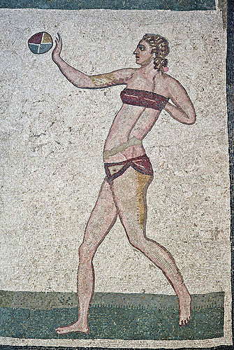 Girl gymnast playing handball in a bikini, fourth century Roman Villa del Casale, near Piazza Armerina, Sicily, Italy