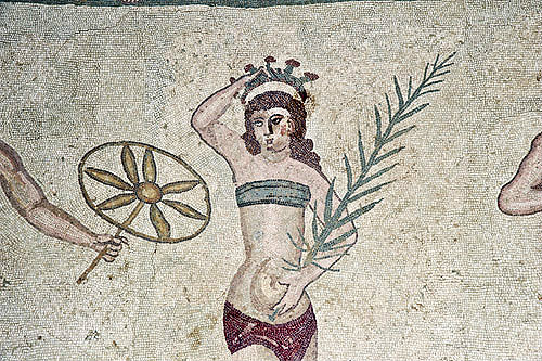 Girl gymnast crowned with flowers and wearing a bikini, fourth century Roman Villa del Casale, near Piazza Armerina, Sicily, Italy