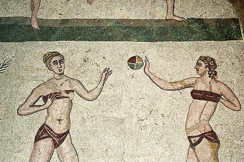 Girl gymnasts playing handball in bikinis, fourth century Roman Villa del Casale, near Piazza Armerina, Sicily, Italy