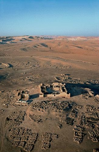 Qasr al-Hallabat, originally second century Roman fort, rebuilt up to eight century, eighth century mosque on left, aerial, Jordan