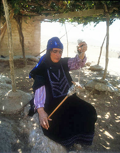 Bedouin woman spinning wool, Jordan
