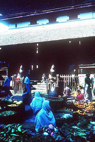 Street market in front of Kasta Mandap, three storeyed public shelter with shrine, of seventh century origin, destroyed in 2015 earthquake, Kathmandu, Nepal