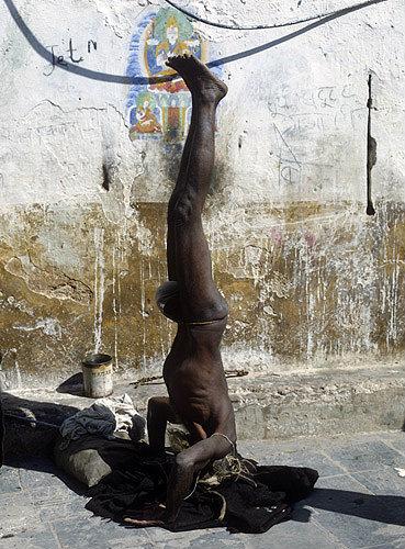 Hindu Yogi standing on his head