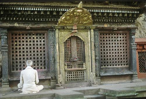 Buddhist at prayer, Nepal
