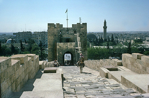 Syria, Aleppo, citadel entrance from inside and a man on a donkey