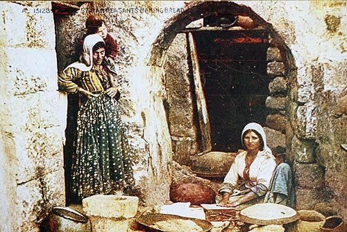Peasant women making bread, circa 1910, Syria