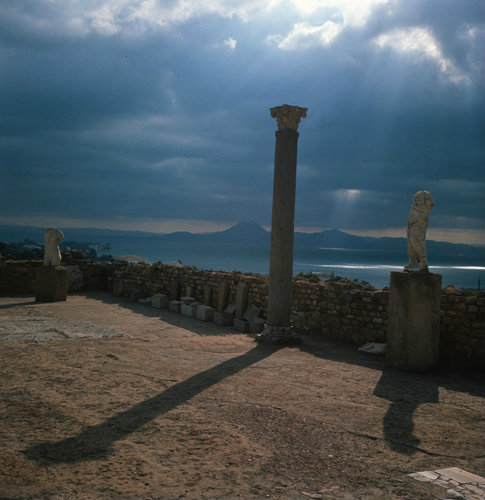 Tunisia Carthage, columns and statue against the sun