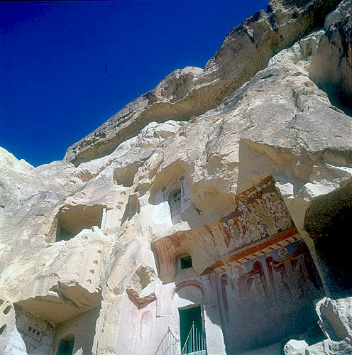 Facade fallen away exposing interior wall paintings in 963-969 AD rock-cut church, Cavusin, Cappadocia, Turkey
