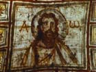 Bust of Christ between Alpha and Omega, mid-5th century painting on the ceiling of Commodilla Catacomb, Rome, Italy