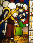 Christ carrying the cross, detail of fifteenth century North East window, Church of St James the Great, St Kew, Cornwall, England