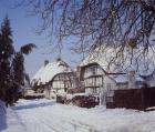 Thatched cottages in snow, Weston Turville, Buckinghamshire, England, Great Britain