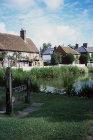 Village stocks in foreground, Albury Village, Hertfordshire, England