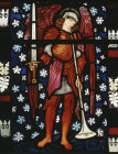 Archangel Michael blowing trumpet, designed by Edward Burne-Jones, 1882, Church of St Peter and St Paul, Cattistock, Dorset, England