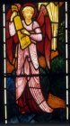 Angel with a dulcimer, angels of Paradise window, by Edward Burne-Jones, 1881, All Hallows Church, Allerton, Liverpool, Lancashire, England