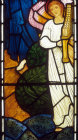 Angel in white with a portable organ, angels of Paradise window, by Edward Burne-Jones, 1881, All Hallows Church, Allerton, Liverpool, Lancashire, England