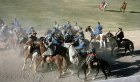 Afghanistan, Kabul, Buzkashi being played in the stadium