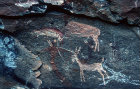 Natal Eland painting of man with boy and arrow shooting Antelope and other animals