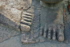 Feet of one of demons on causeway, Angkor Thom, completed late twelfth century by King Jayavarman VII, Cambodia