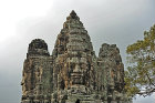 Three of four carved faces on gopura, south gate, Angkor Thom completed late twelfth century by King Jayavarman VII, Cambodia