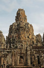 Bayon temple, main prasat (behind) and gopura at entrance to third enclosure on south side, Angkor Thom, Cambodia