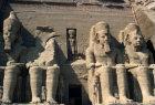Egypt, Abu Simbel, Temple of Ramesses II, four seated colossi of Ramesses II on temple facade