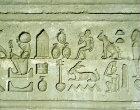 Hieroglyphs, sunk relief on the eastern facade of Temple of Hathor, Dandara, Egypt