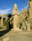 Egypt, Karnak, the temple of Amun, colossal statue of Ramesses II with his consort, Nefertari, between his knees