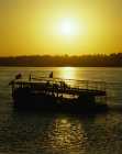 Egypt Luxor ferry on the Nile at sunset