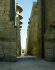 Egypt, Karnak, Temple of Amun, view from second pylon through the hypostyle hall to the granite obelisk erected by Thutmose I