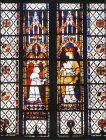 Donor Raoul de Ferrieres presenting model of window to Virgin anad Child, fourteenth century, north clerestory, Evreux Cathedral, France